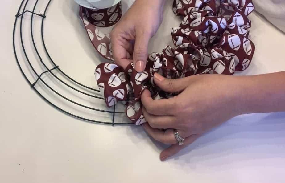 football ribbon loops on wreath frame