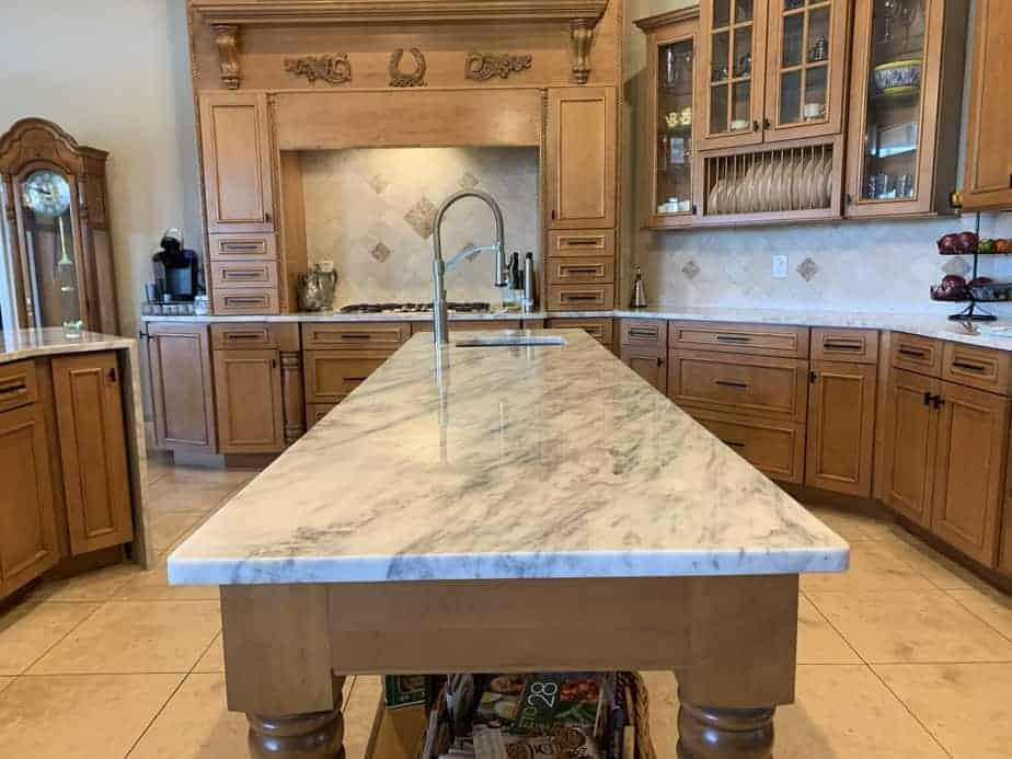 White marble with wood cabinets