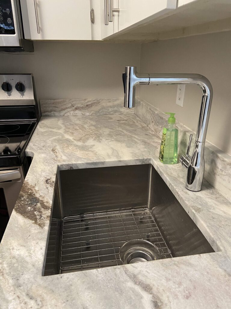 New sink and faucet in condo flip