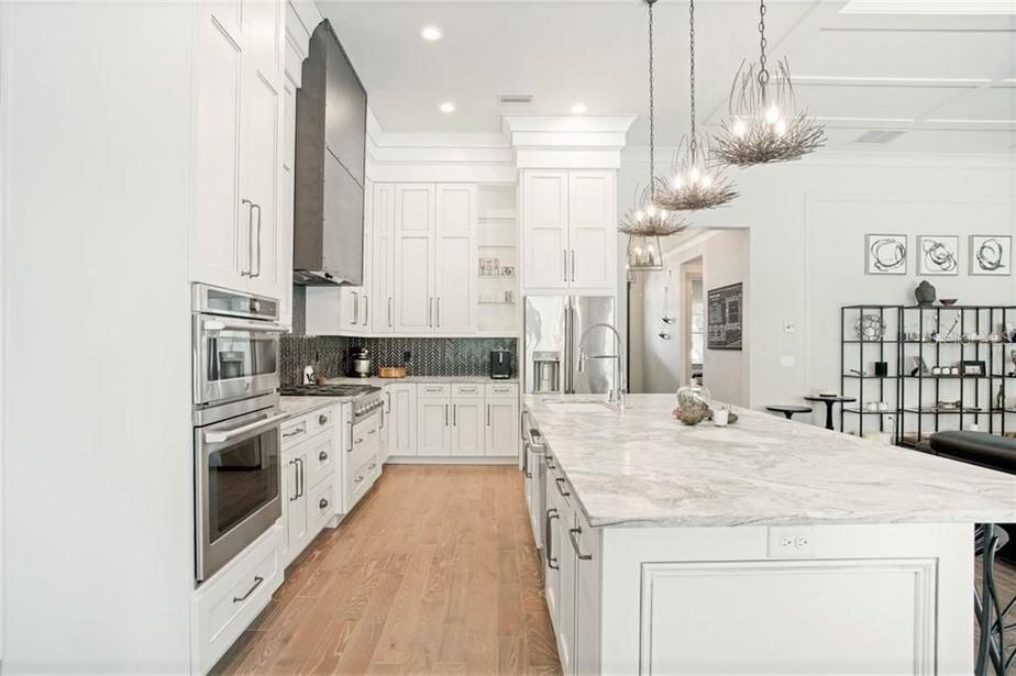 White kitchen dark gray backsplash