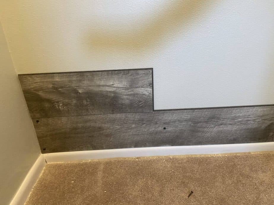 Vinyl plank flooring attached to wall