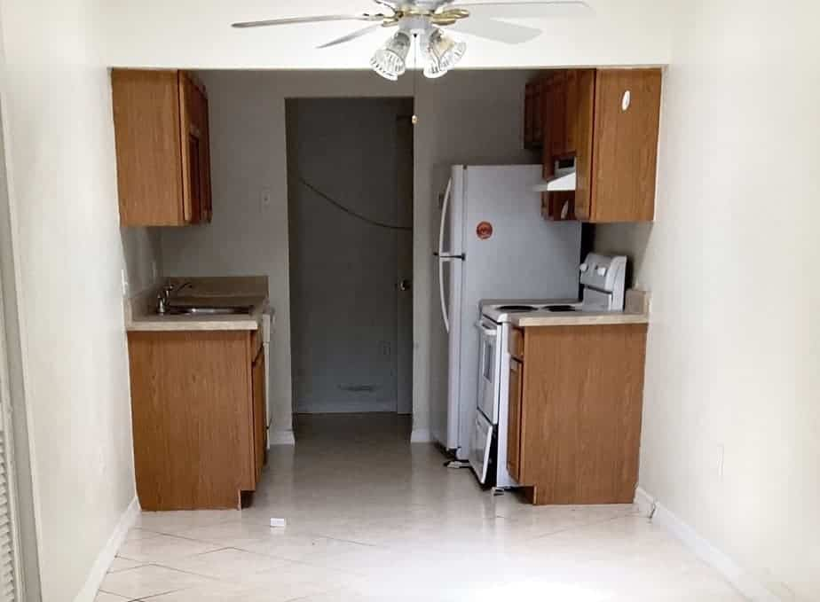 Kitchen before condo flip renovation