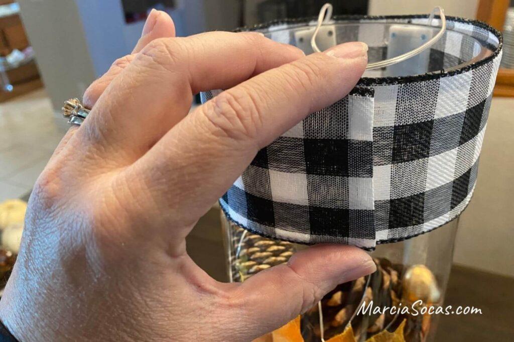 wrapping ribbon border on glass cylinder vase