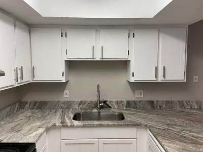 white kitchen cabinet with cabinet pulls