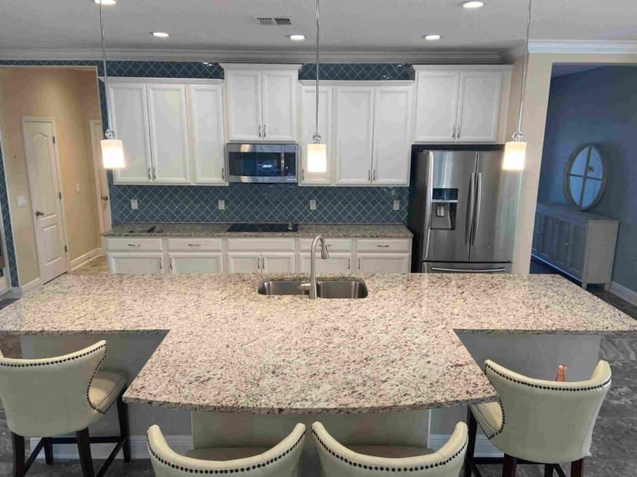white kitchen with blue arabesque tile backsplash