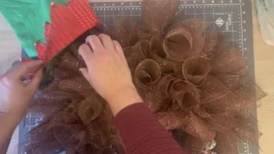 add hat to christmas door wreath