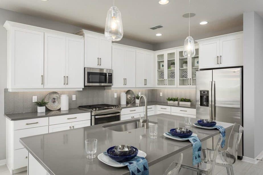 white kitchen gray countertops and gray backsplash