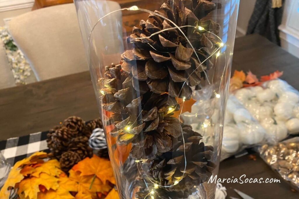 making pine cones with fairy lights vase