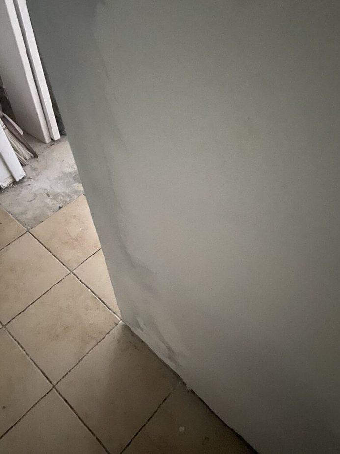 damaged drywall at entryway