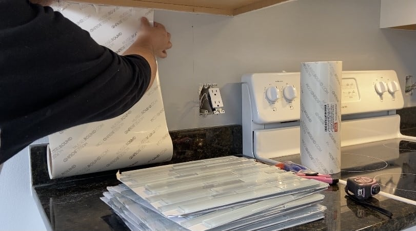 Unroll the mat when you install backsplash using adhesive tile mat