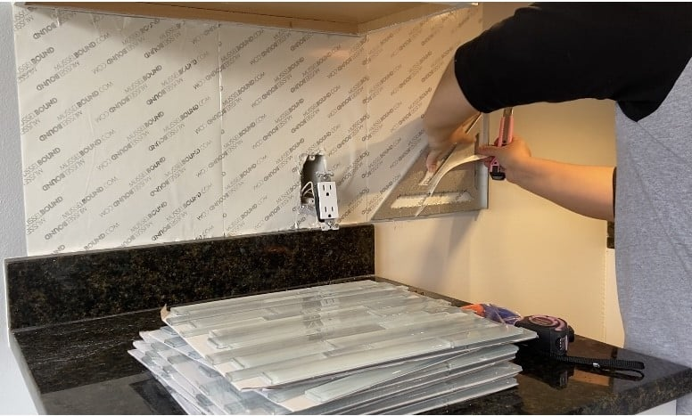 Use a straight edge to cut and install backsplash using adhesive tile mat