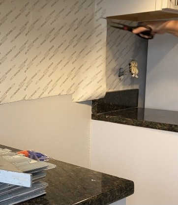 Cutting the adhesive mat for tile backsplash